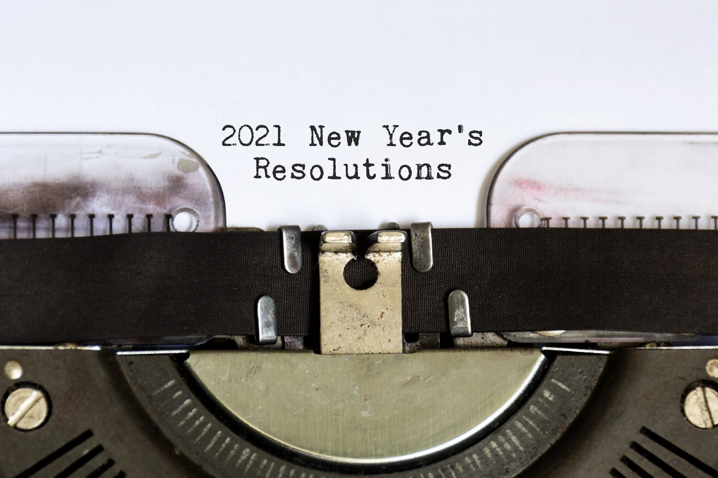 2021 New Year's Resolutions typed by a typewriter.