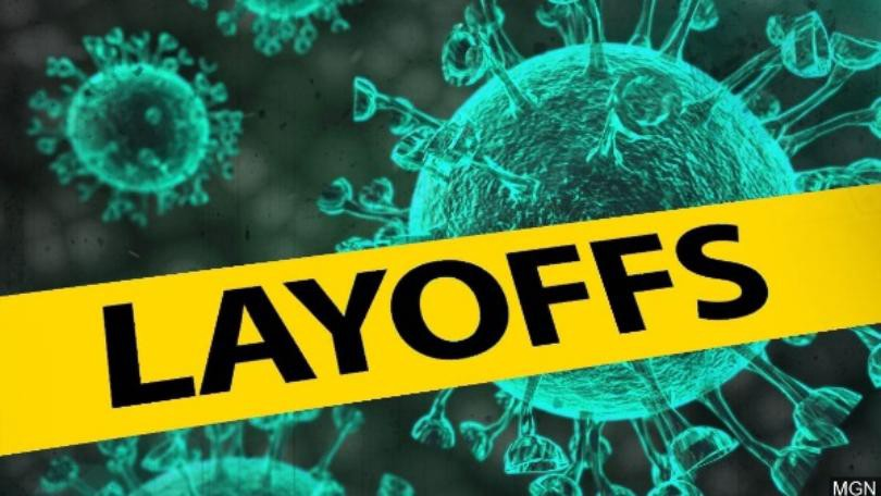 Layoffs sign in front of Coronavirus image