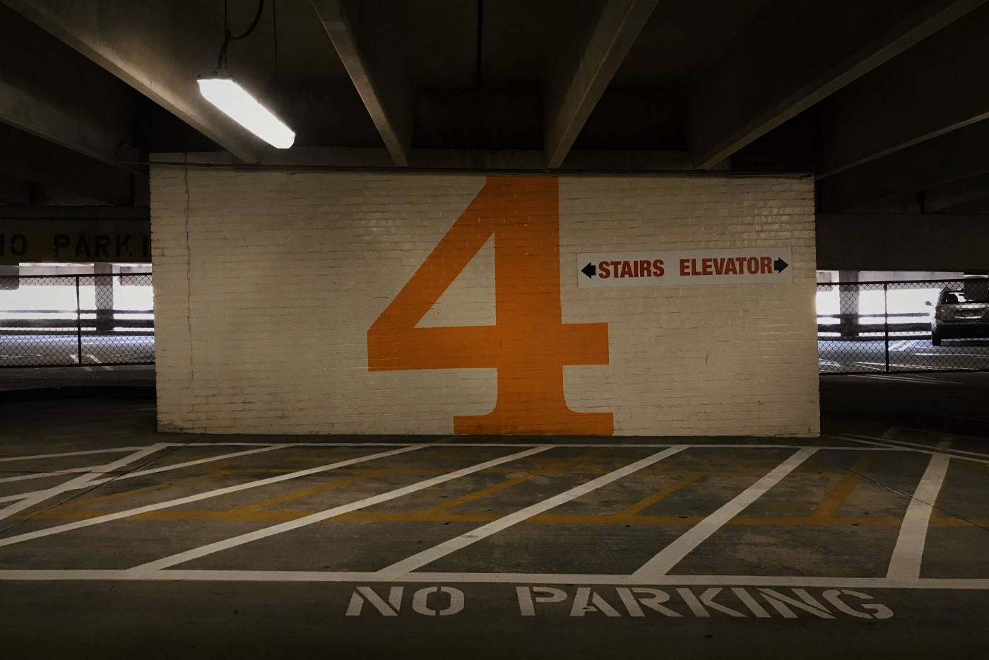 Image of a giant number 4 in a parking garage. Image Jordan Graff