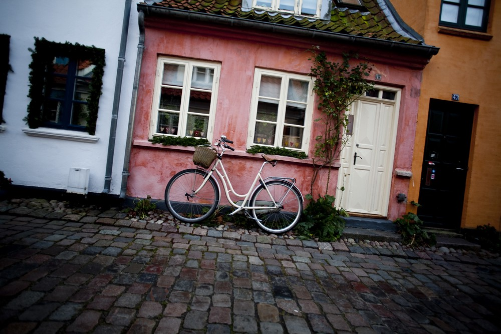 A danish row of homes with a bike.
