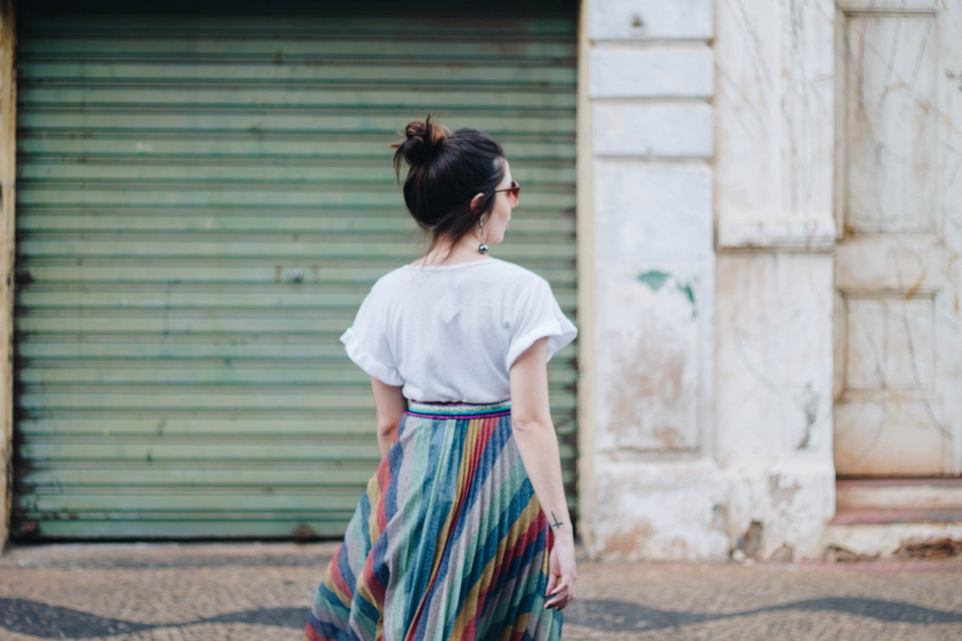 Girl in colourful skirt crossing road after quitting job