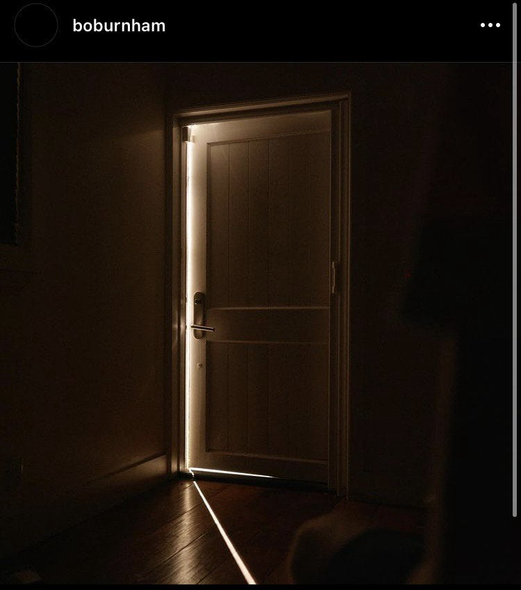 A photo posted by Instagram user @boburnham. A slightly-opened door is lit by a massively bright spotlight outside that suffocates the darkness of the room itself.