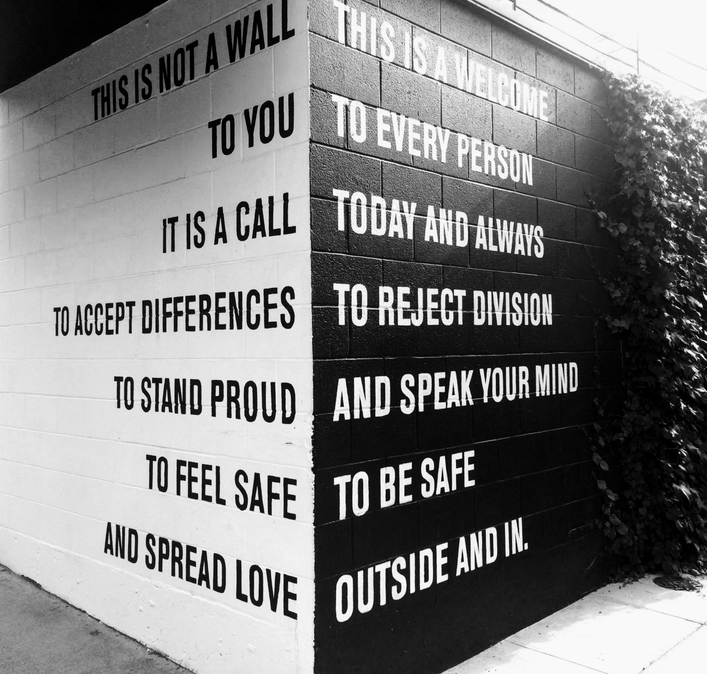 Black and white wall with words.
