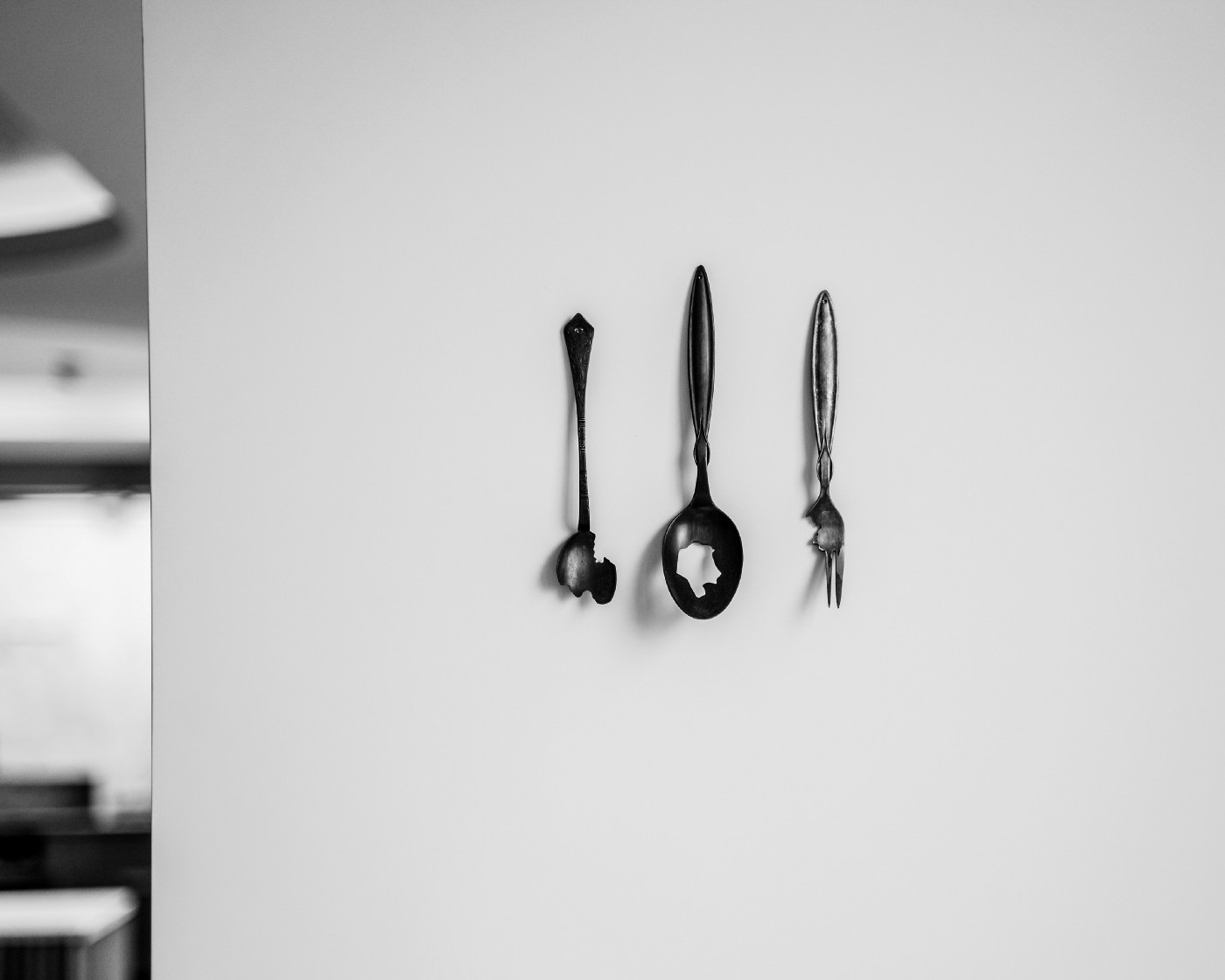 Restaurant kitchen crockery displayed on a white wall to represent hospitality in London. Photo by Food Story Media agency.