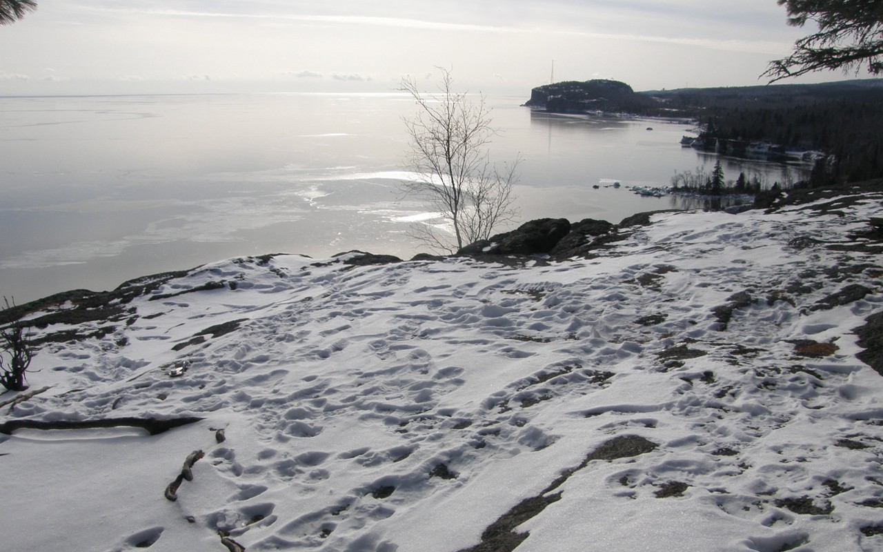 Footprints in the snow all mixed together on the shores of Lake Superior