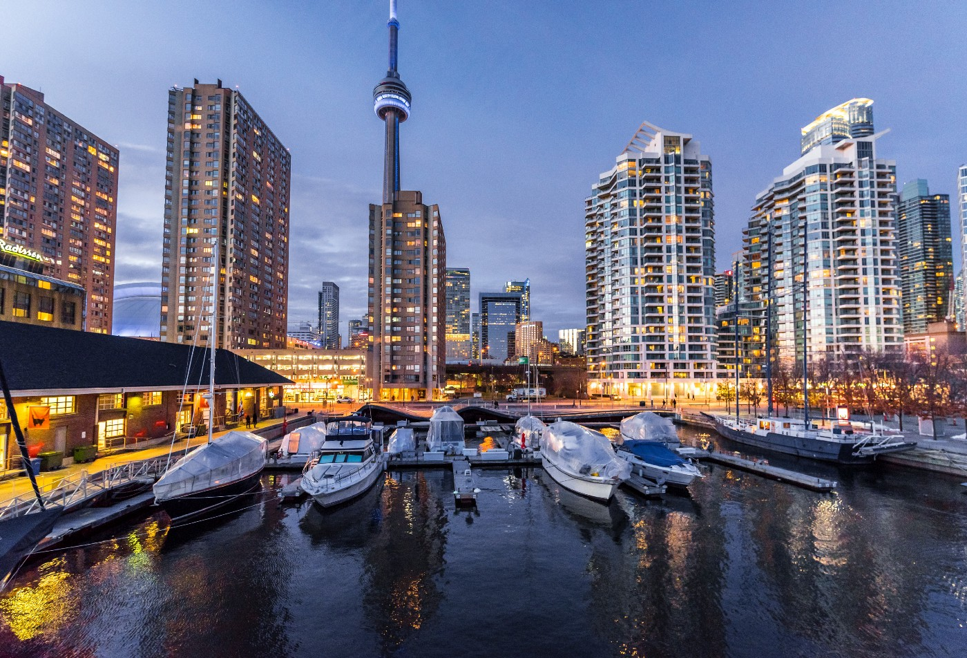 A photo of the Toronto harborfront, with lots of rich people's boats and condo towers and the CN Tower. Toronto's nice as far as cities go, but let's be honest, it's a farm for harvesting time and money from millions of humans.