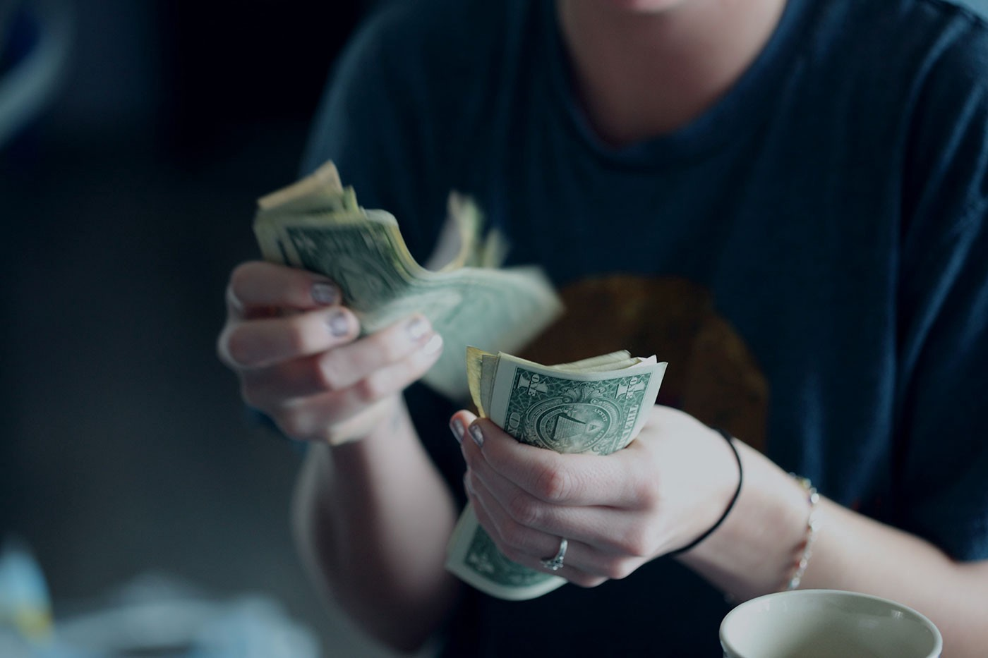 woman counting out cash
