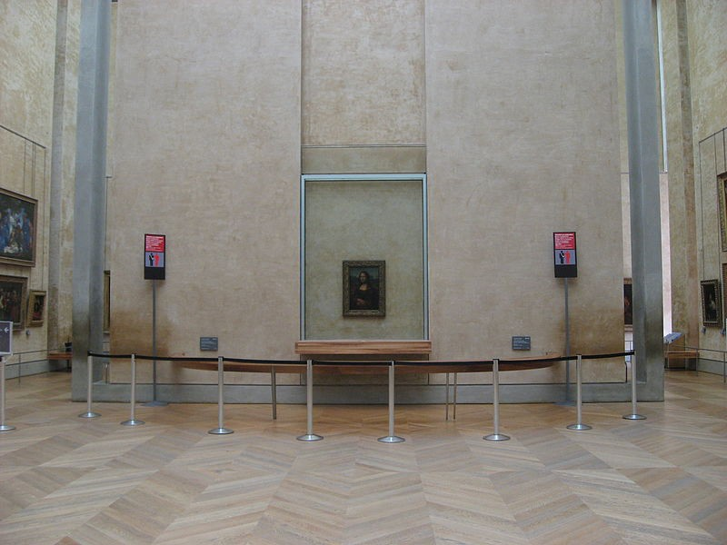 A gallery room with paintings without any people.