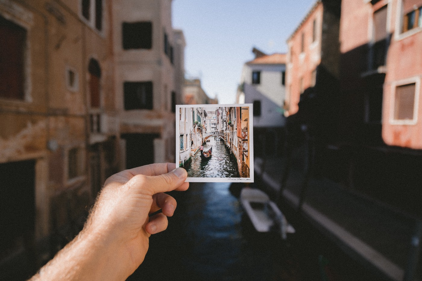 a person holding a photo of grand canal photo