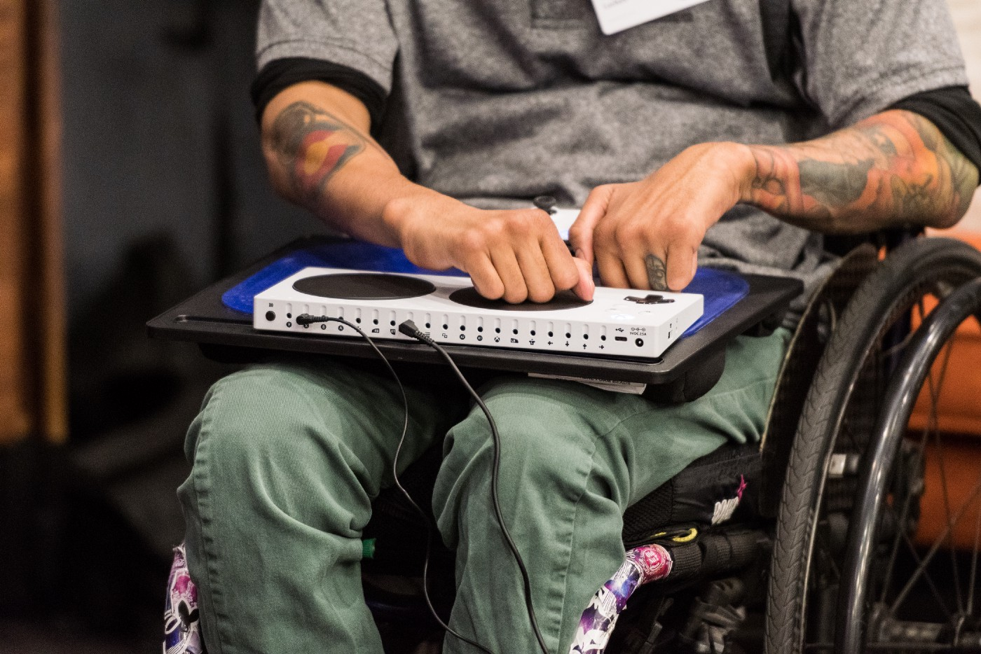 Figure 2: Person in a wheelchair with a Microsoft Accessibility Controller (Fleming, 2019)