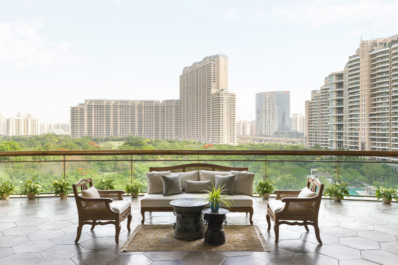 Balcony with a sofa set, overlooking the golf course