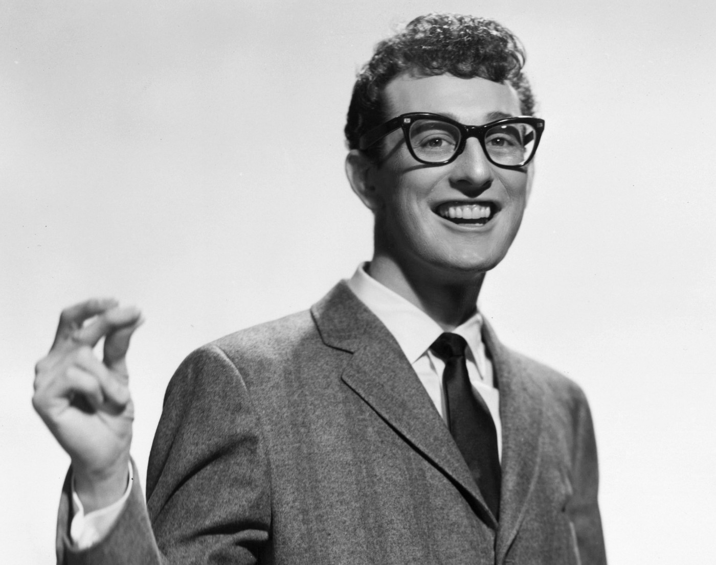 Image of black and white photograph of rock singer Buddy Holly