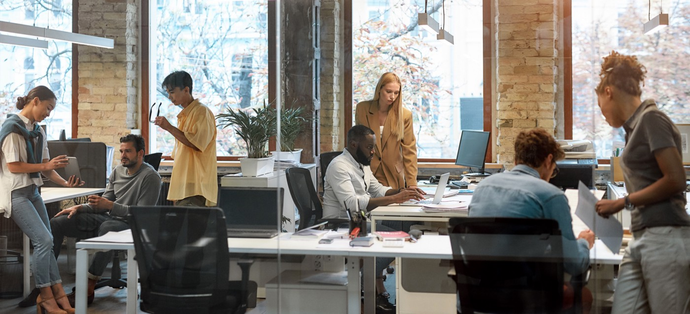An open-concept coworking space is shared by diverse workers from different organizations.