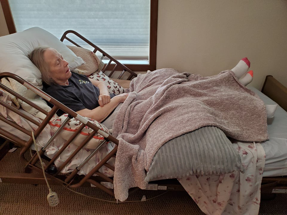 Writer Lonna Whiting's mother Beth Gregory rests comfortably in her room at a Minnesota memory care unit. Gregory has been living with dementia since 2013 and is currently receiving end-of-life hospice cares.