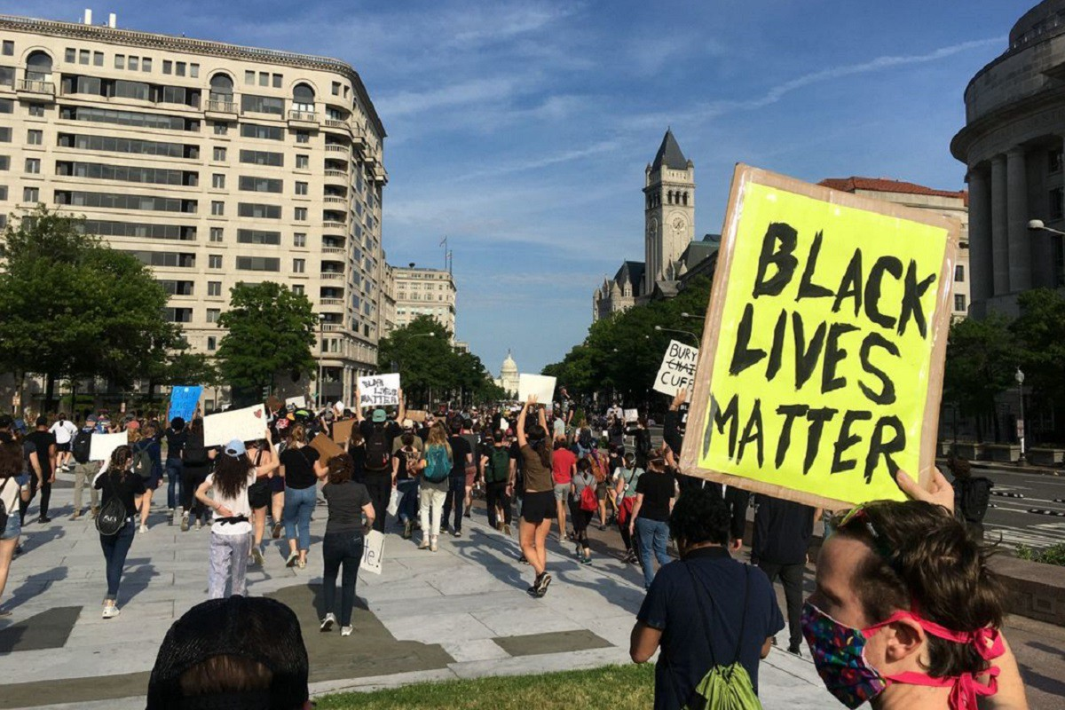 """A protestor at a Black Lives Matter rally holds up a sign that reads, """"Black Lives Matter."""""""