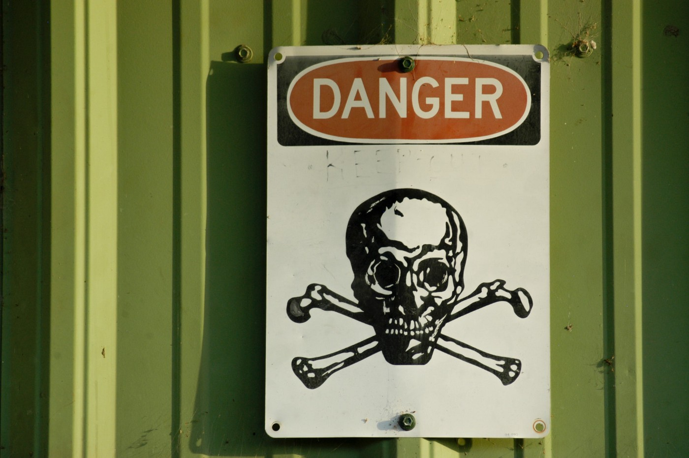photo of danger sign with skull and cross bones