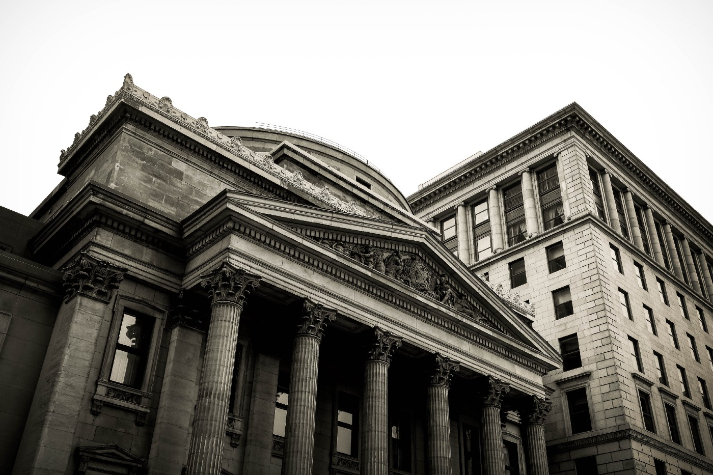 A stone bank with pillars and a fancy roof. You know, those horrible institutions that get rich by bankrupt the poor.
