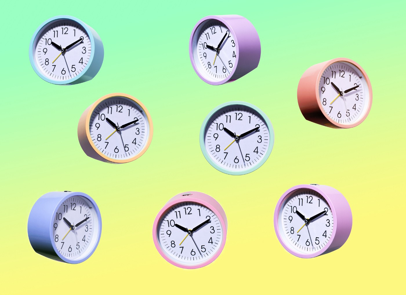 Multicolored clocks falling against a yellow-green gradient.