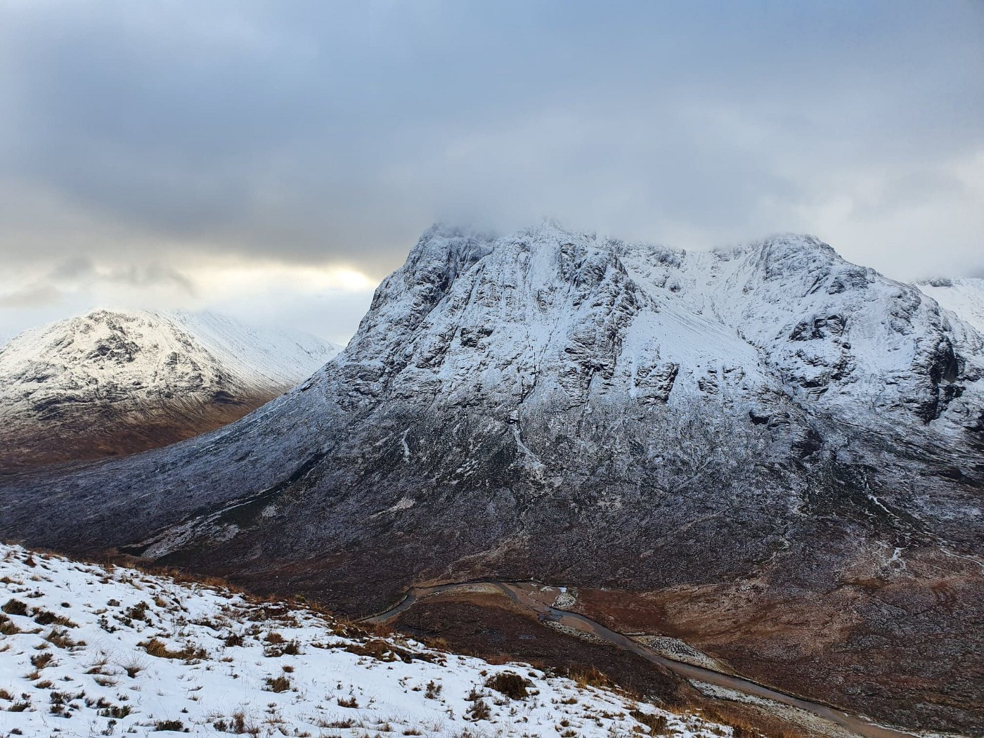 Rugged, rocky, snow covered mountain—The Buachaille