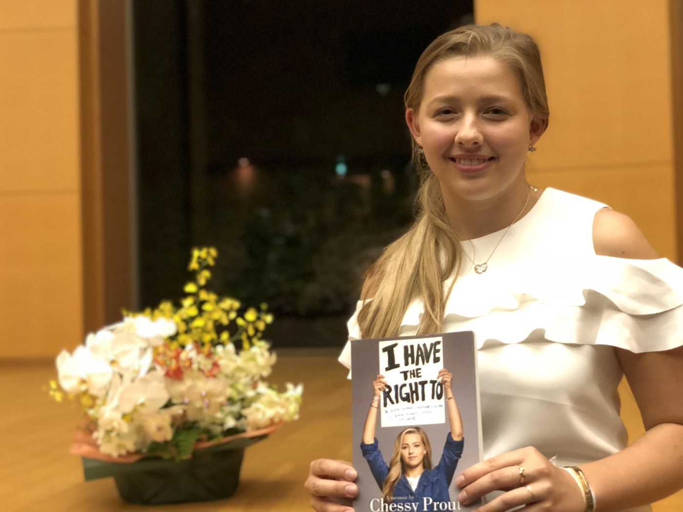 "Chessy Prout holding a copy of her memoir, ""I Have the Right To""."