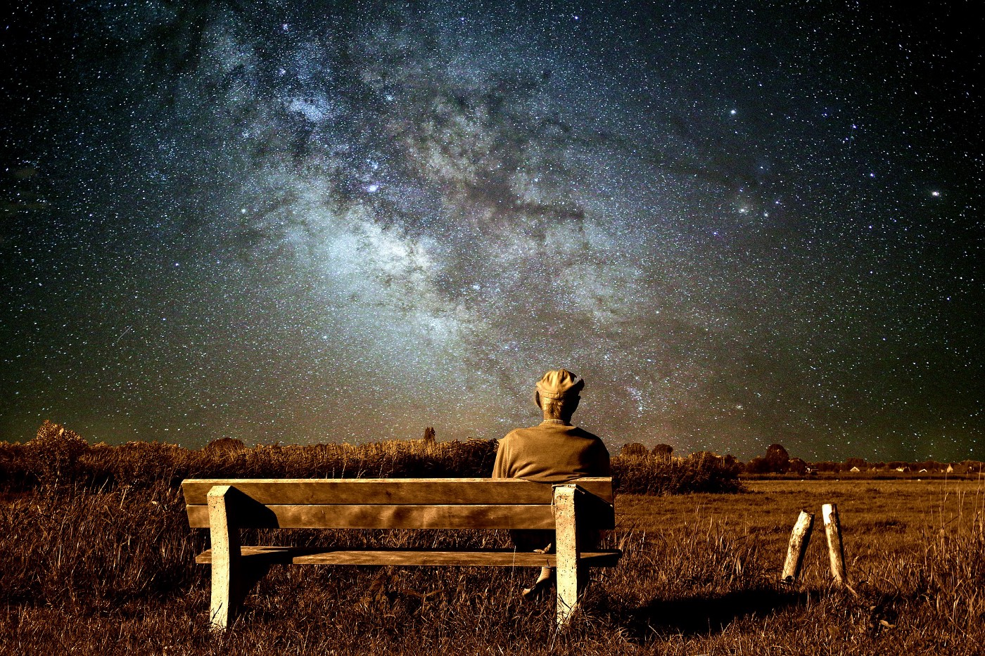Old man on bench watching the galaxy.