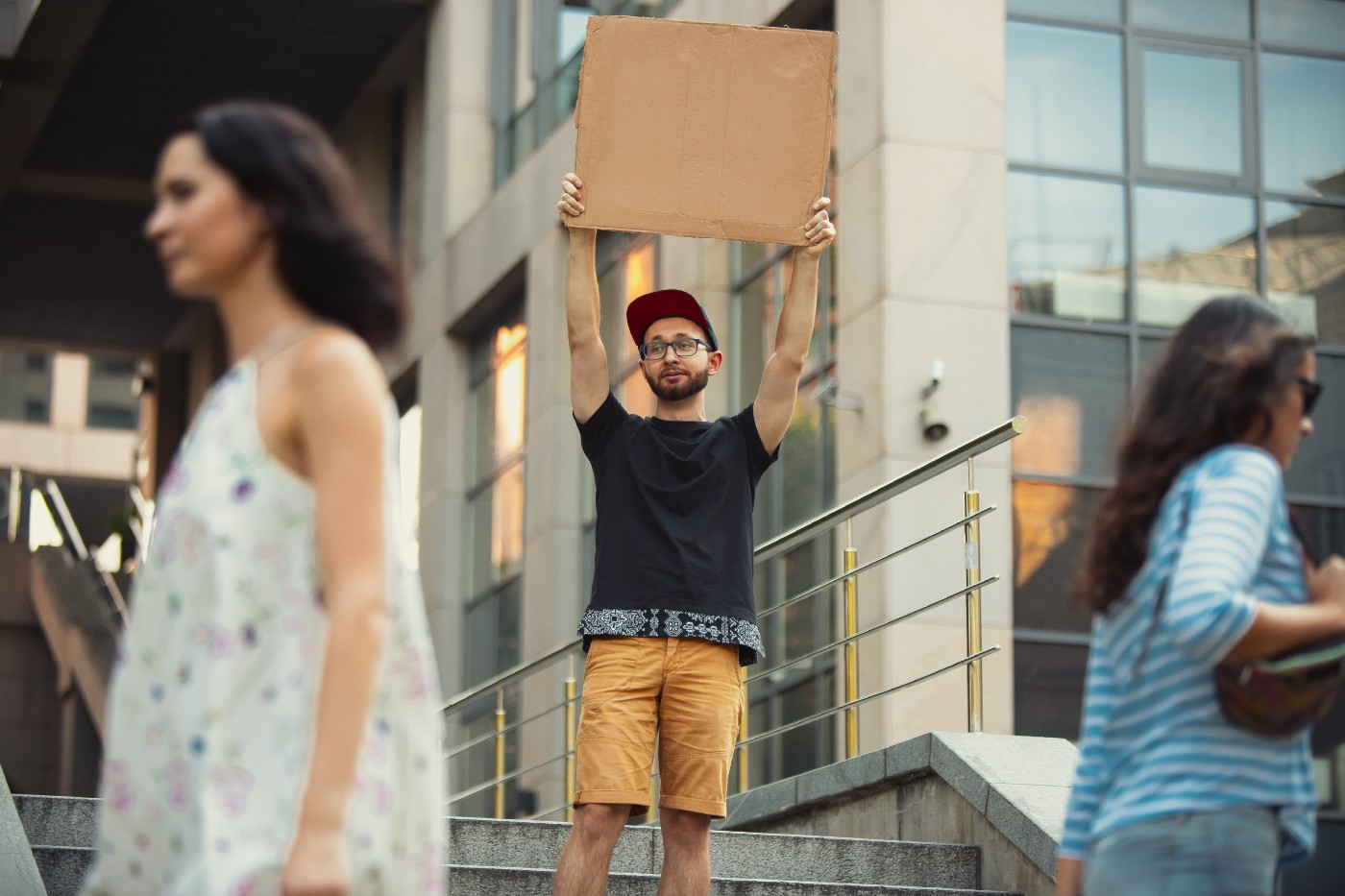 Man with empty sign.