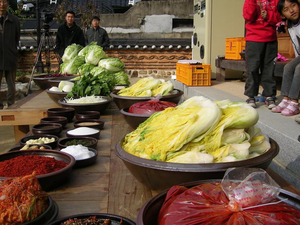 The ingredients for making kimchi, displayed on a table outside.
