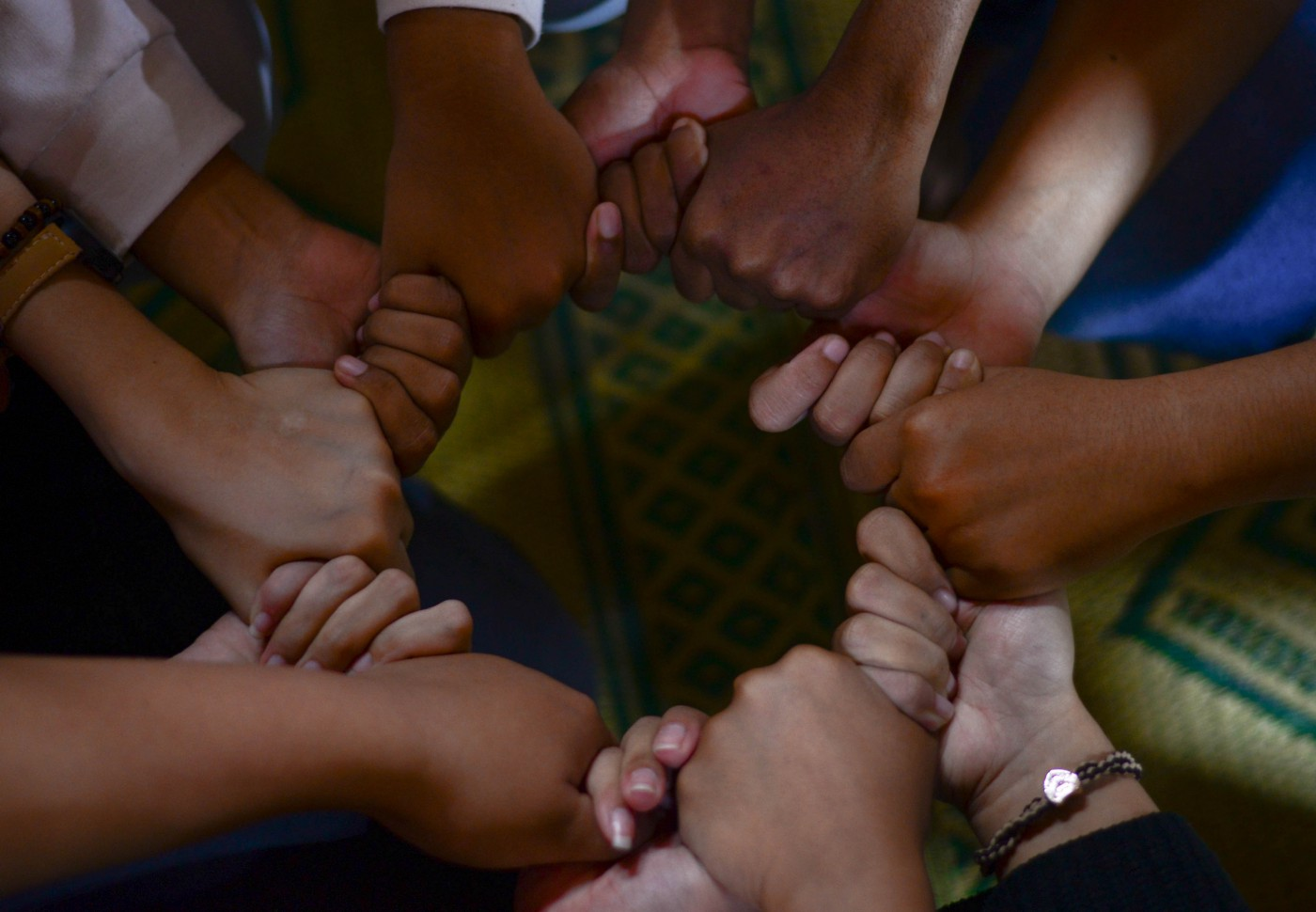 Hands clasped together forming a circle.