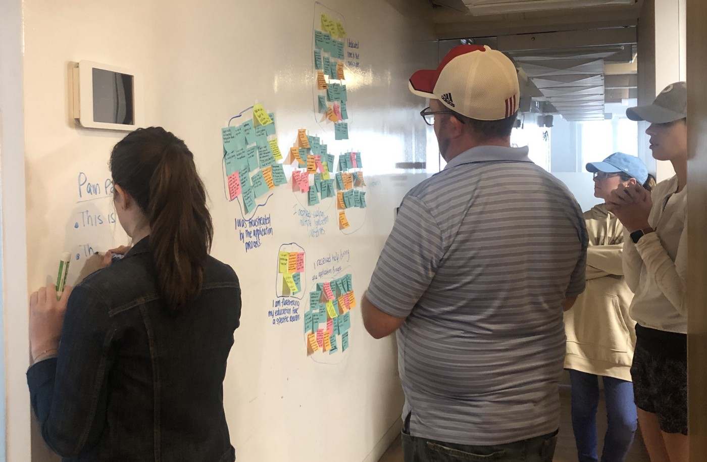 (From left to right) Megan Barbanel, Phil King, Katie Speidel, and myself (in the back) working on our affinity map