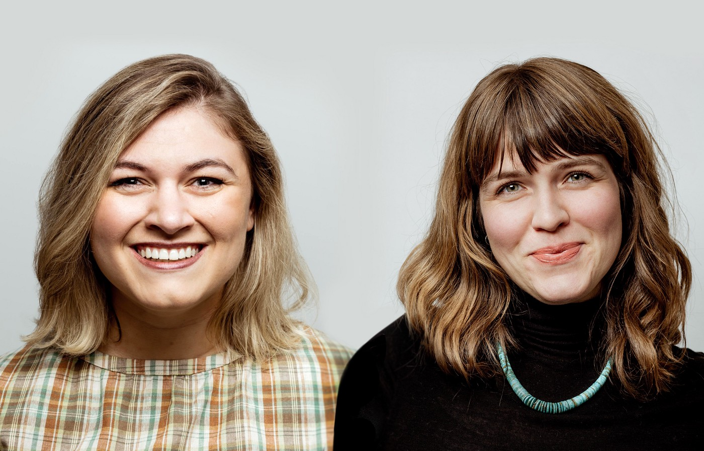 The authors smile brightly with Nora Elena Genster on the left and Claire Odom on the right against a neutral background.