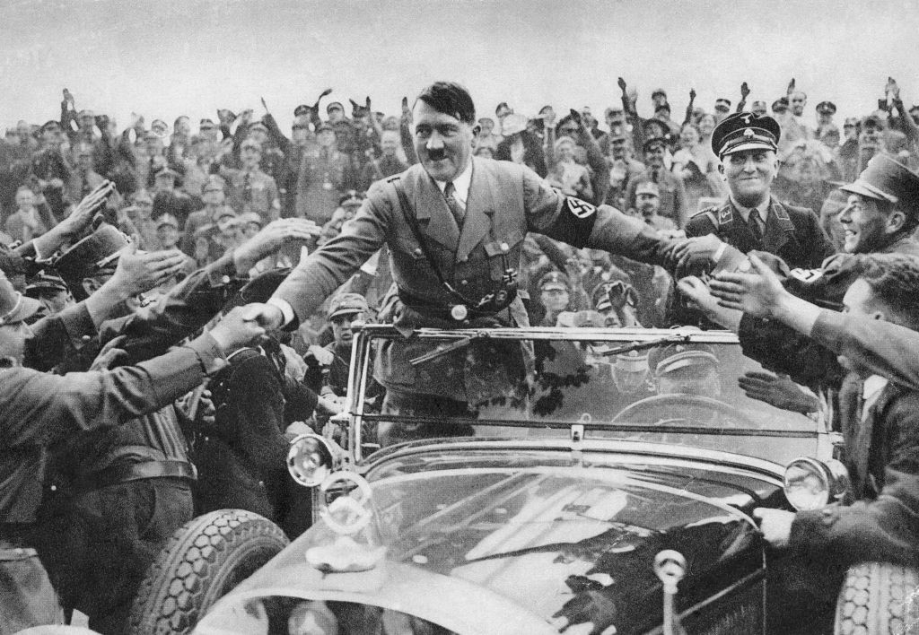 An archival photo of Hitler in the midst of a crowd in Nuremberg.
