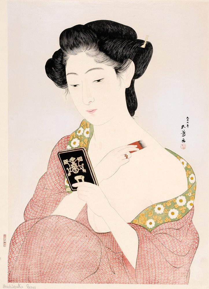 """A picture of Hashiguchi Goyo's """"A Woman Applying Makeup"""", 1918. Woodblock Print. A Japanese woman looking into a black ornate handheld mirror, brushing white paint onto her body."""
