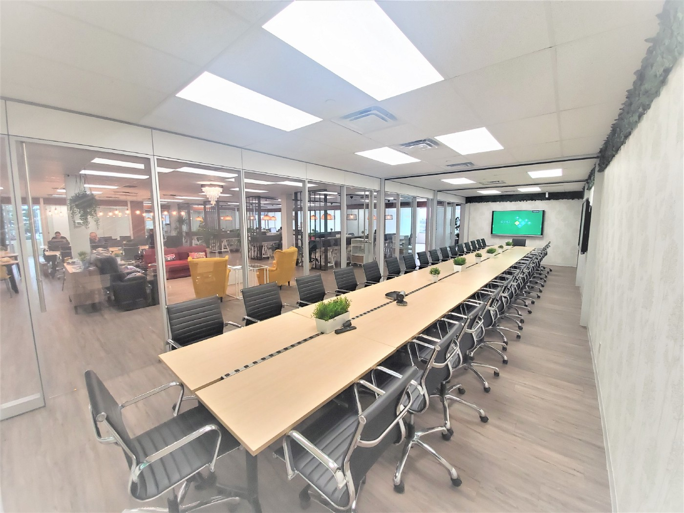 Touchdown Coworking Space Conference Room—Seats 34 people, is 572 sqft and 44 feet long.
