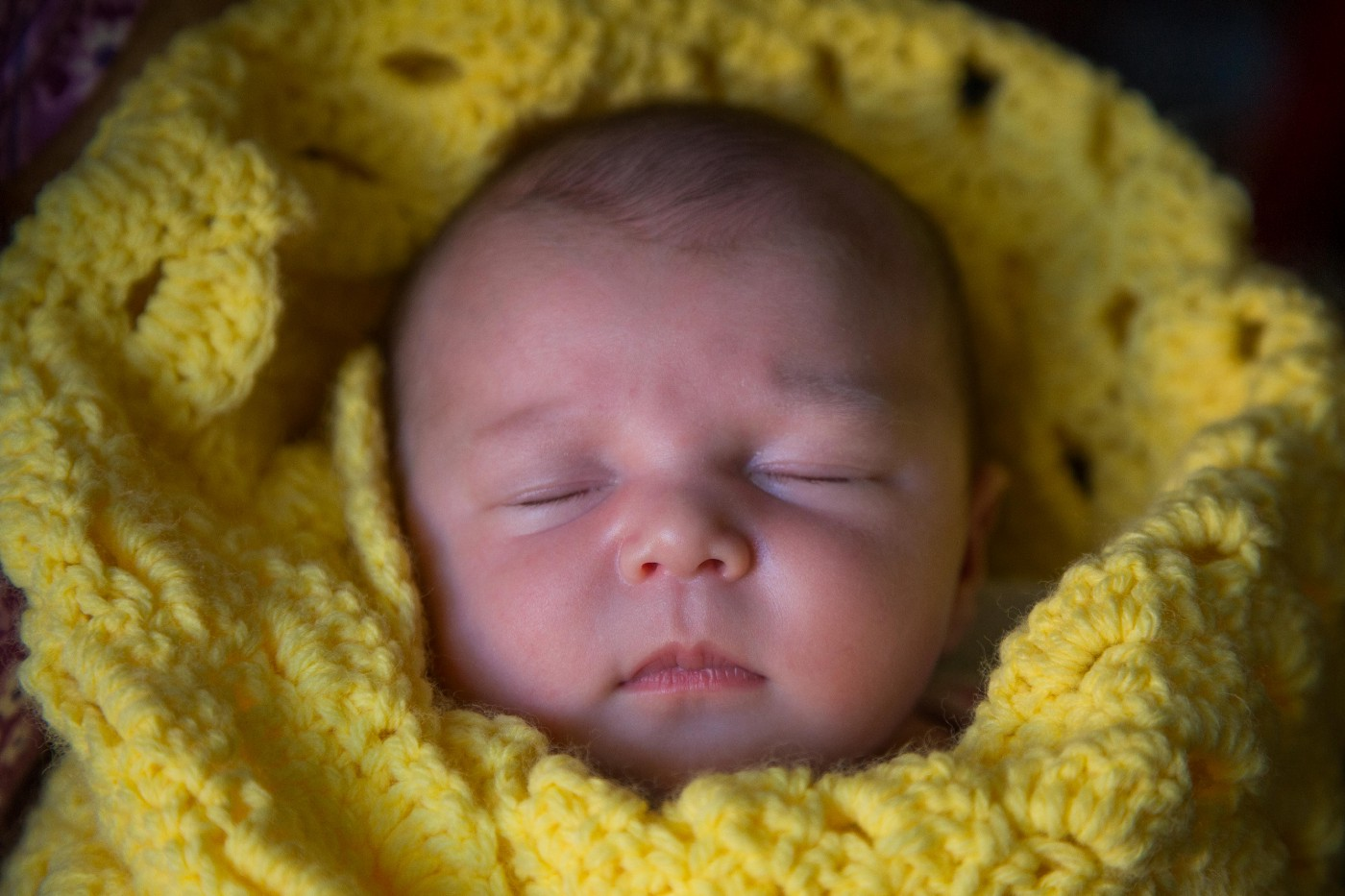 Invincible Summer—a personal photo of the author's daughter shortly after she was born, wrapped in a yellow blanket.