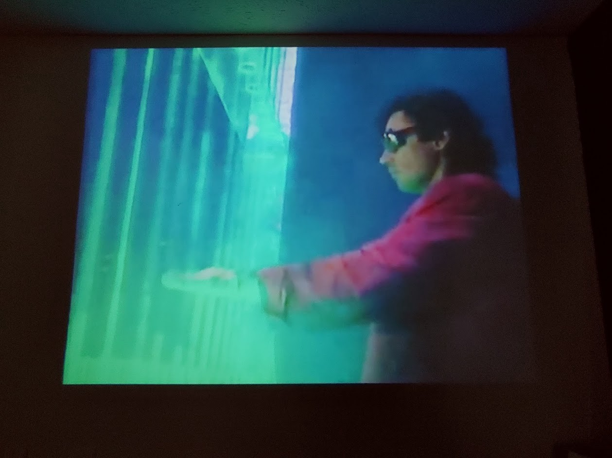The image of aman (Jean-Michel Jarre) putting his hands out into a laser light, and in doing so, striking musical notes