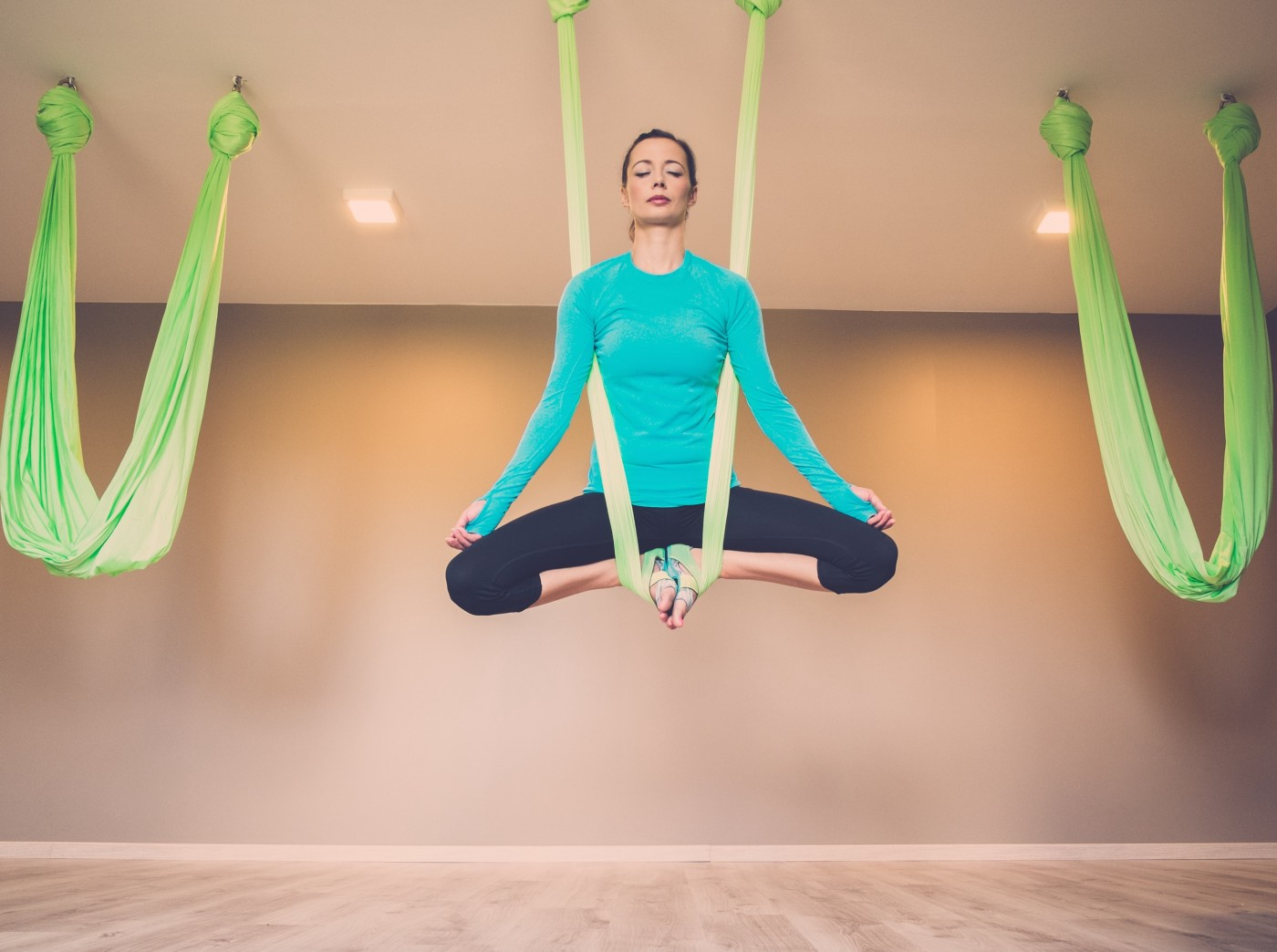 Flying High Aerial Yoga. Surrender to the force of gravity and ...