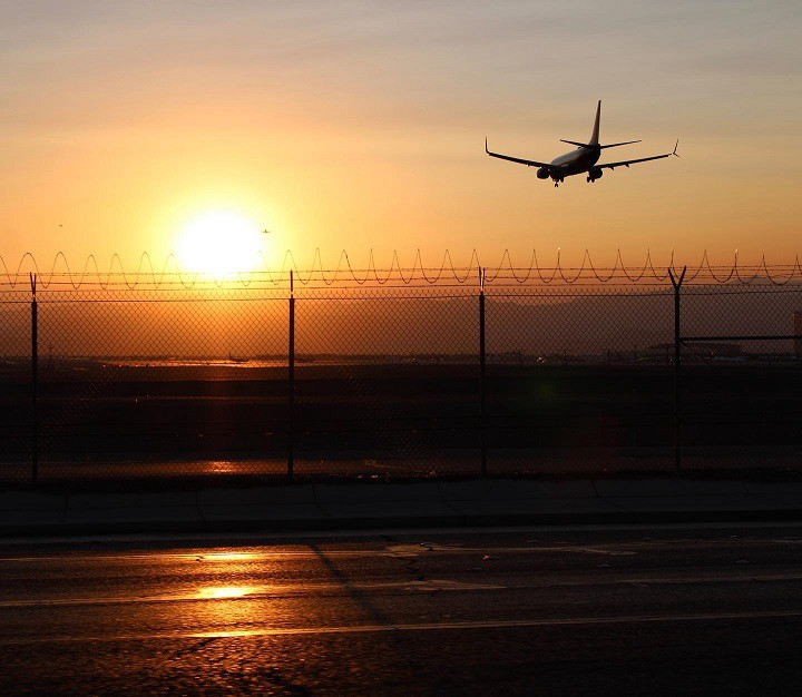 A plane coming in for a landing at Las Vegas' McCarran airport at sunset.