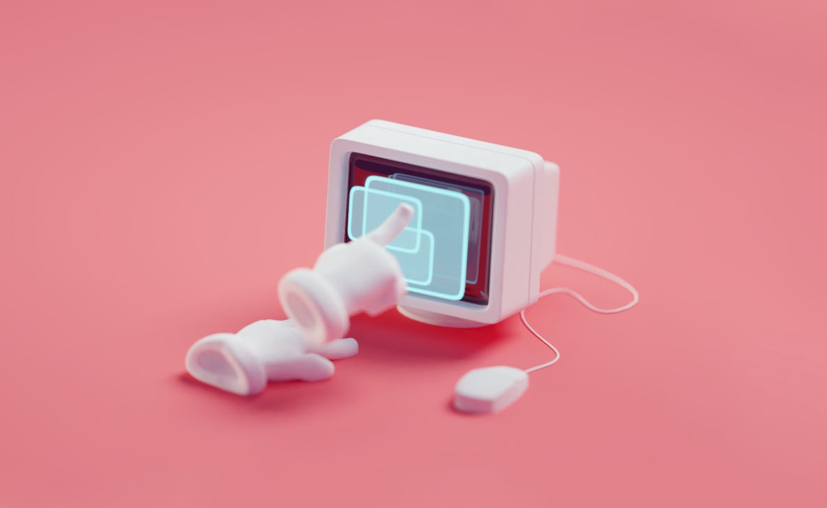 White gloves pointing at an old CRT monitor with a pink background