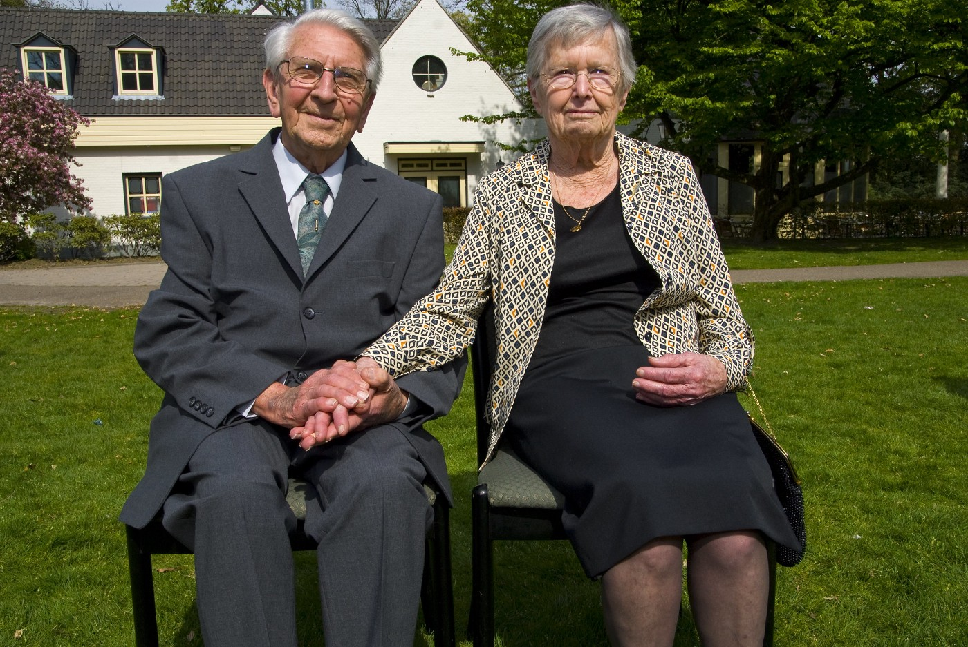 white grandmother and grandfather on chairs on lawn. family, mental health, parenting, relationships, society, equality, injustice, politics, future