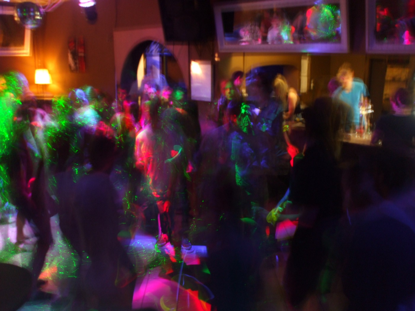 Dancing and drinking people in club at night