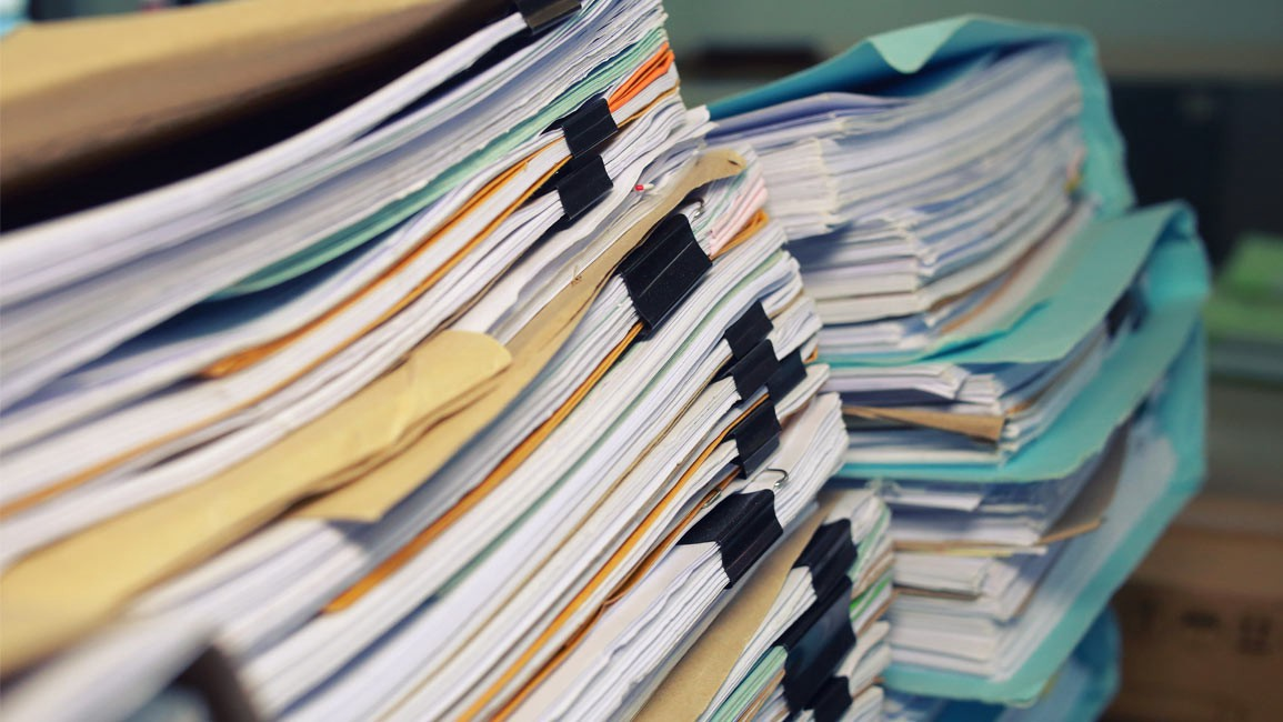 Large stack of documents. Source: https://www.cuberms.com/news/3-reasons-why-legal-document-storage-is-important-to-law-firms-and-solicito/