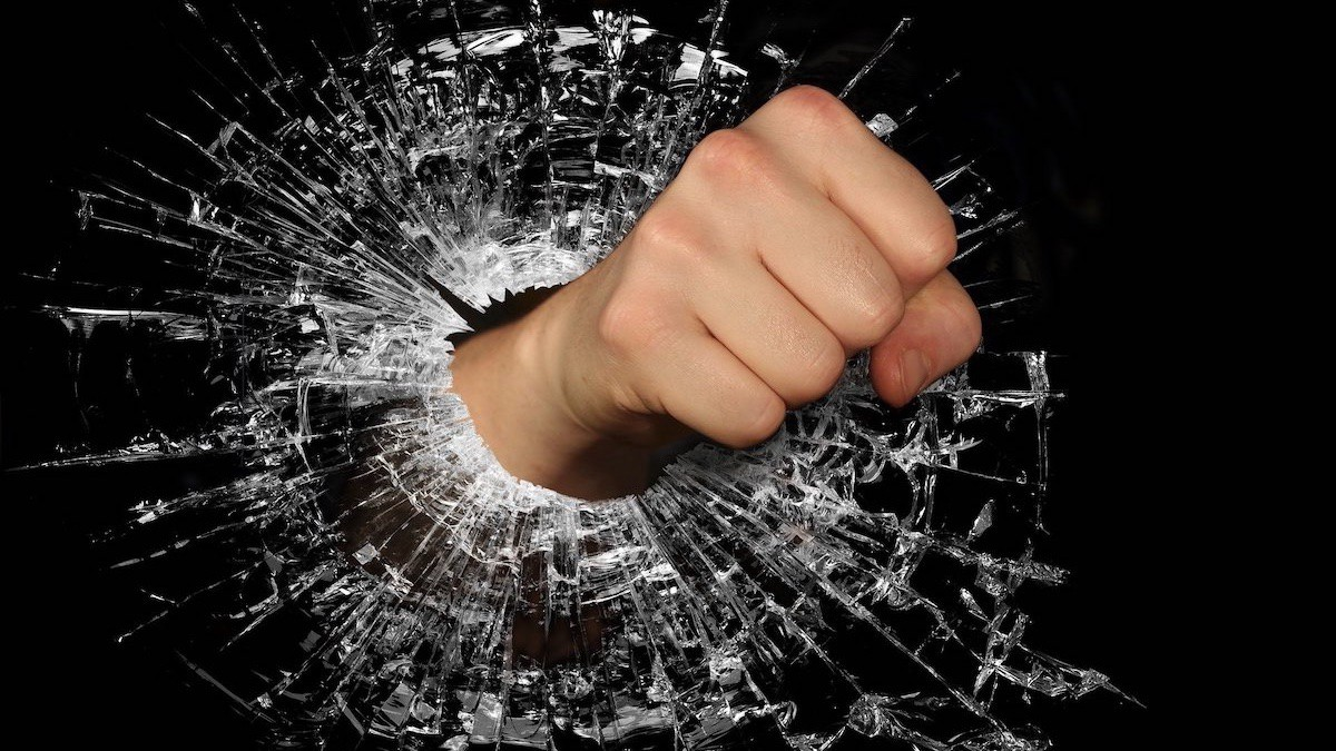 A fist punching through glass.