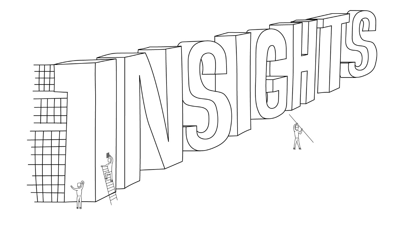 Three people working together to construct the word 'insights' written in large letters