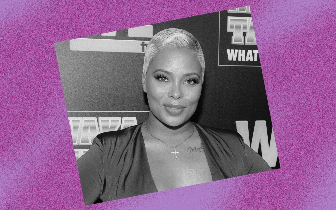 Black and white photo of Eva Marcille against a violet background.