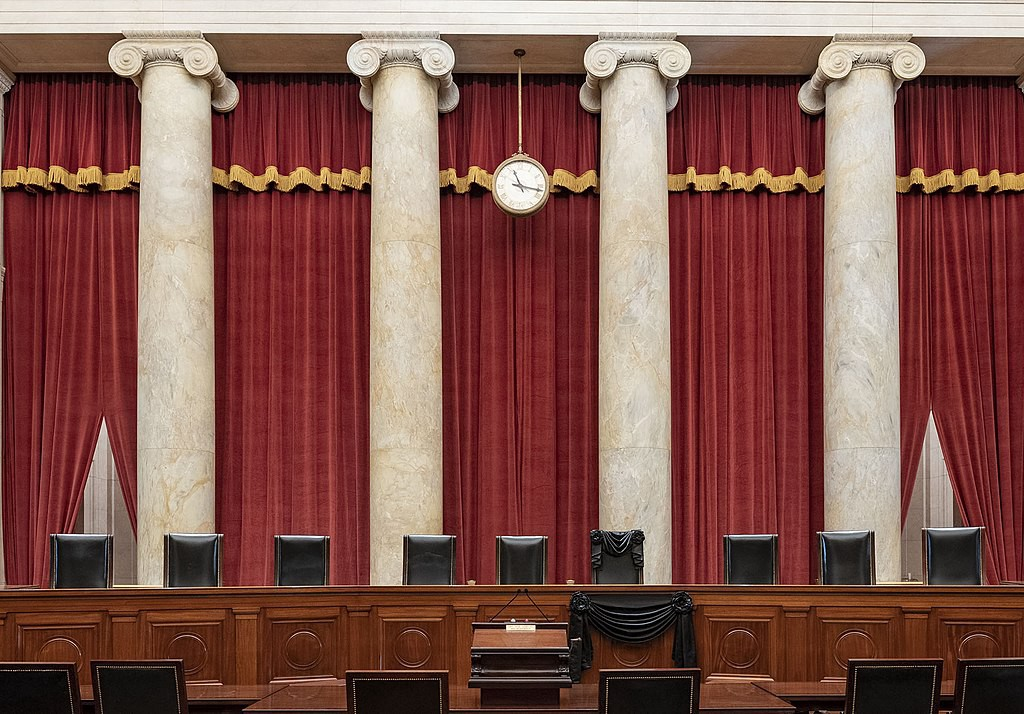 The Courtroom of the Supreme Court showing Associate Justice Ruth Bader Ginsburg's Bench Chair in black following her death.