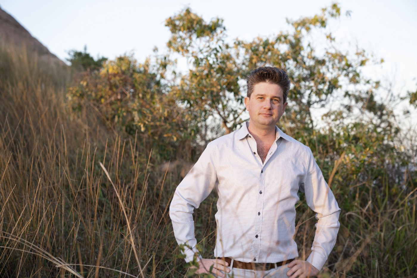 Colour photo of Nathan Hubbard posing for a photo in the North Queensland bush.
