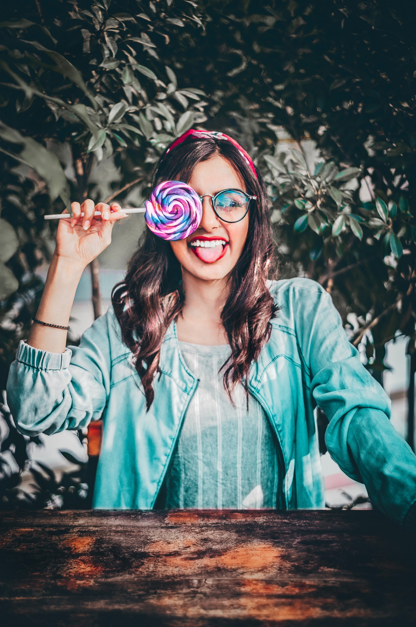 Woman holding lollipop up to face