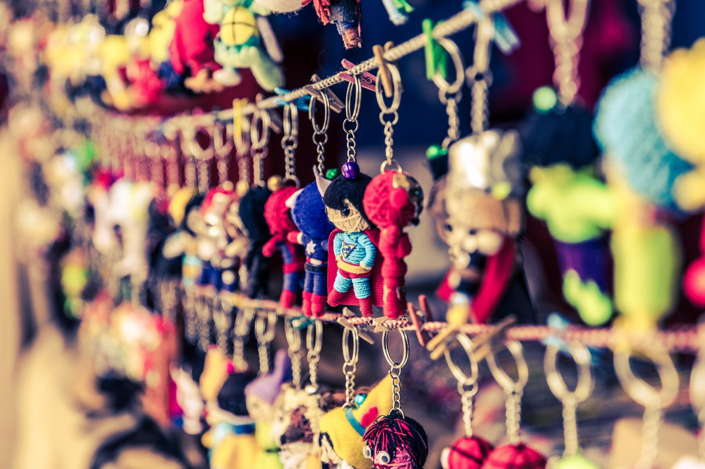 A picture of keychains hanging on rows of rope.