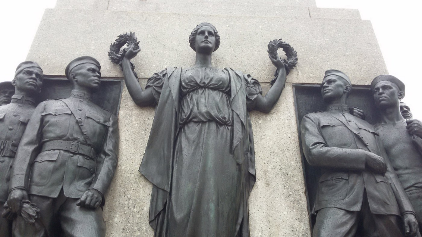Photograph, by author, of the All Wars Memorial to Colored Soldiers and Sailors, Philadelphia, from 1934, showing Black American soldiers and sailors, in bronze, looking at a female figure of Justice holding laurels.