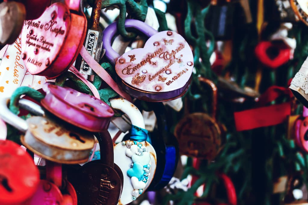 Heart-shaped lockets tied to a fence